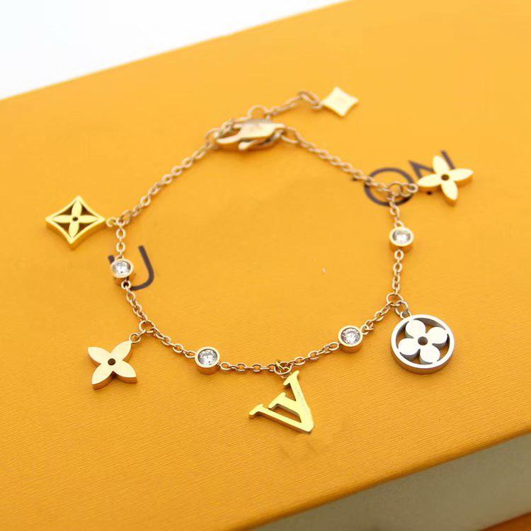 Kommen neue Art und Weise Dame 316L Titanstahl 18K überzog Gold Bracelets mit Diamant-V Brief höhlen heraus 5Pcs vier Blatt-Blumen-Anhänger