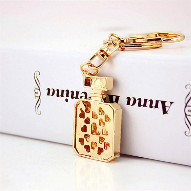 Moda cristallo bottiglia di profumo portachiavi borsa borsa fibbia borsa per auto portachiavi titolare anello chiave delle donne