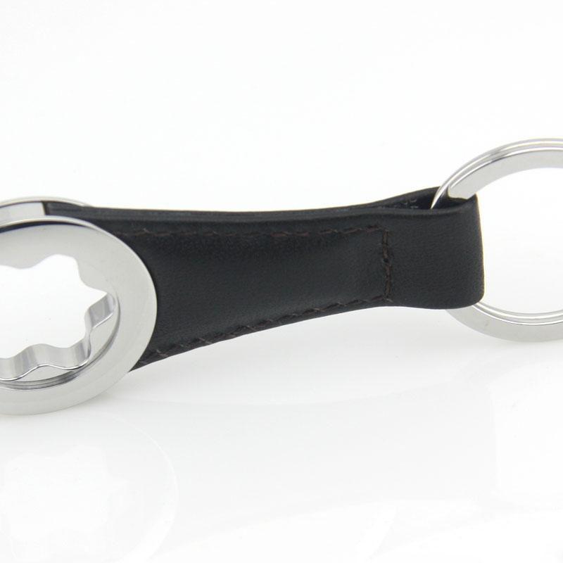 Mode Hommes Keychain Célèbre concepteur TeyRing Fabriqué en cuir et en acier inoxydable Ne changez jamais la couleur a une boîte