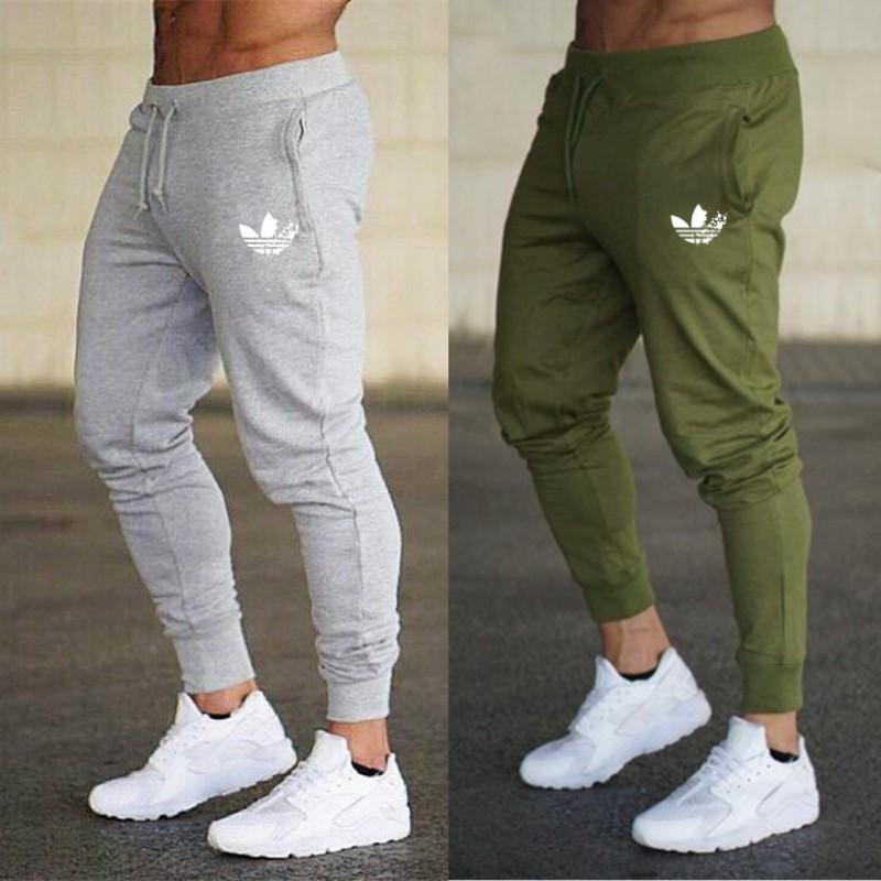 Новый спортивная одежда фитнес брюки повседневная полиэстер мужская фитнес тренировки брюки тощий тренировочные брюки Брюки Jogger