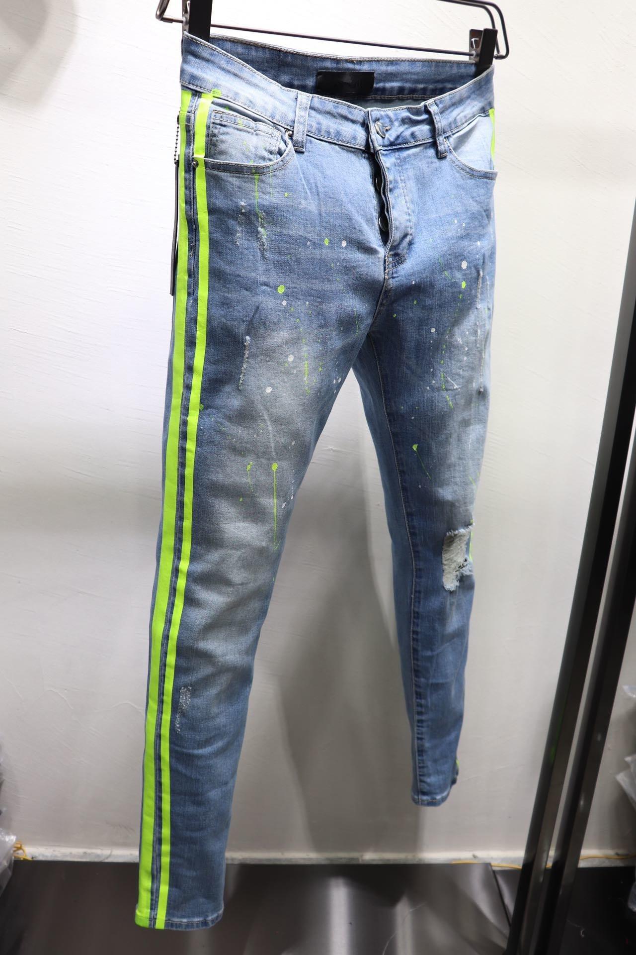 Nuovi arrivi Solido classico stile adatto di modo del motociclista Designer Mens Jeans Stripe rotto Hole Stripes superiore Denim Pants Dimensione 29-40