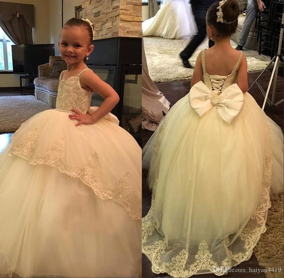 2019 New Arrival Puffy Flower Girl Dresses For Weddings Spaghetti Straps Lace Appliques Beaded Bow Girls Pageant Dress Kids Communion Gowns