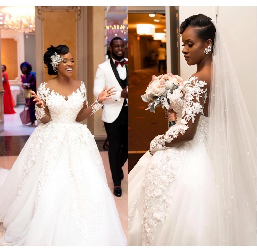 Africaine élégante mariée sirène robes de mariée 2020 Sheer manches longues en dentelle Applique Robes de mariée Bouton Retour Vestidos de novia
