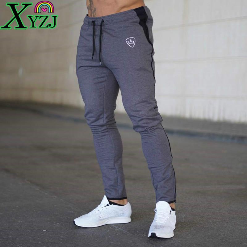 Lápiz Pantalones Hombres Nuevo Músculo Fitness Moda Nuevo Al aire libre Casual Culturismo Correr Entrenamiento Entrenamiento Gimnasio Pantalones deportivos Dos Homens Ropa deportiva