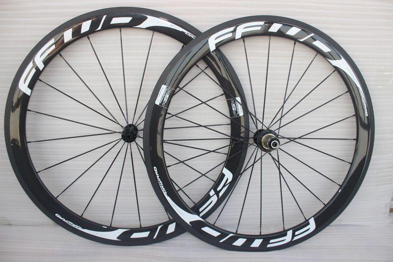 مبيعات المصنع 700C الكربون العجلات الفاصلة أنبوبي لايحتاج الكربون 50mm دراجة عجلات الفاصلة الدراجة الطريق عجلات البازلت الكبح