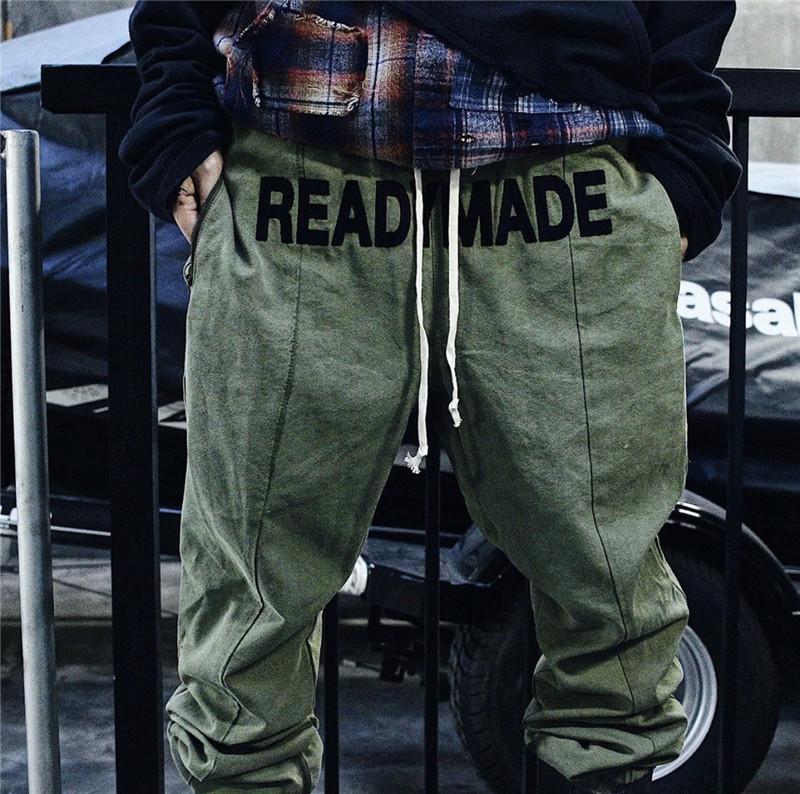 20SS nueva alta calidad de Hiphop prefabricados Pantalones Streetwear militar de camuflaje Hombres Mujeres algodón de la manera pantalón Joggers V200411