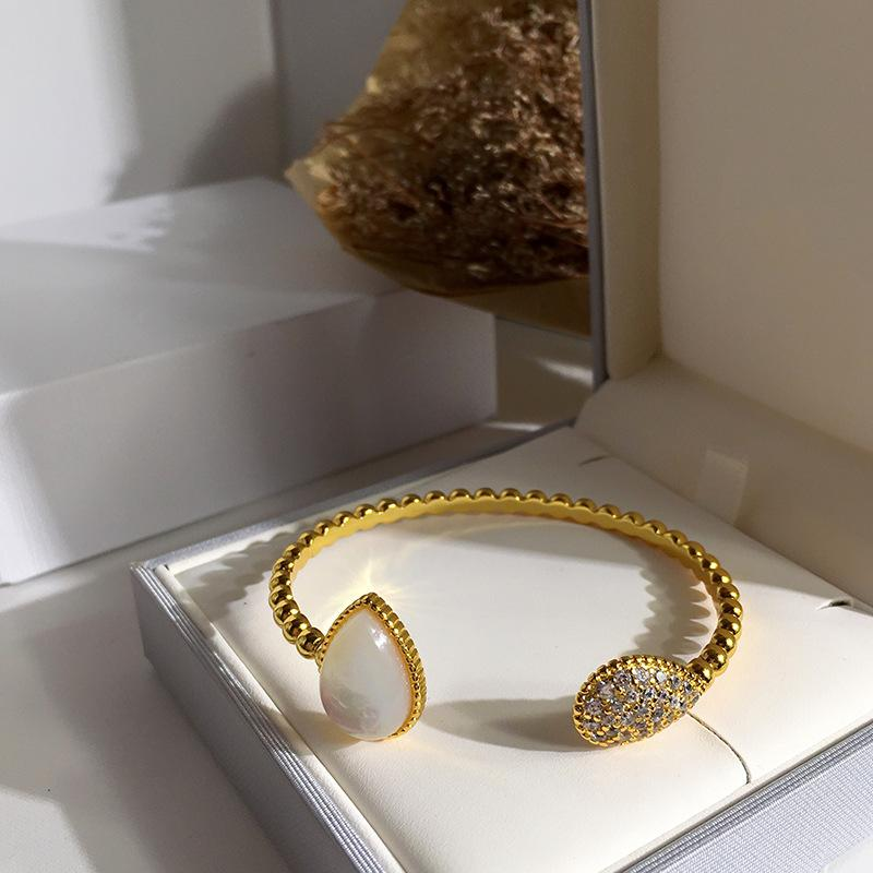 Al por mayor de moda de Nueva Marca de acero de titanio pulsera de oro Agua Gotas de apertura ágata pulsera encanto de las mujeres para la joyería