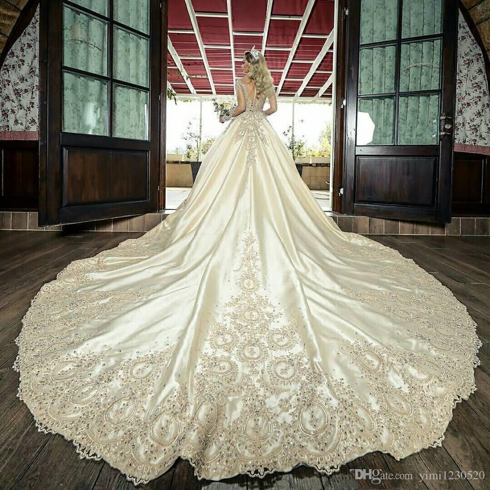 Vestidos de novia de lujo 2021 Vestidos nupciales Sheer Cuello de manga larga Catedral Train Crystal Beads Chapel Vestidos de Novia Tallas grandes
