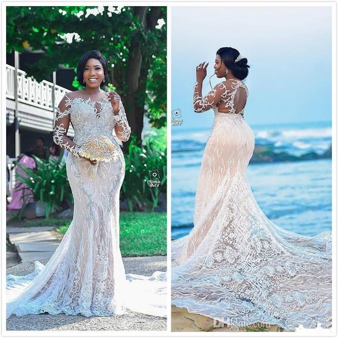 Lussuoso pizzo in rilievo abiti da sposa Mermaid africana Sheer collo Abiti da sposa maniche lunghe Vintage sexy abiti di nozze Robe de mariée