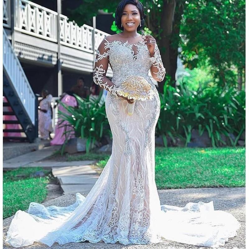 Afrikanische Plus Größe Brautkleider Sheer Hals Robe de Mariee Backless Brautkleider Perlen / Pailletten Lange Ärmel Spitze Meerjungfrau Hochzeitskleid