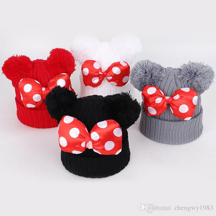 4 colores del bebé Pom Pom Beanie casquillo del niño de los niños de los bebés calientes del invierno del ganchillo gorro de punto arco de piel del sombrero del arco ZJY820 mayorista
