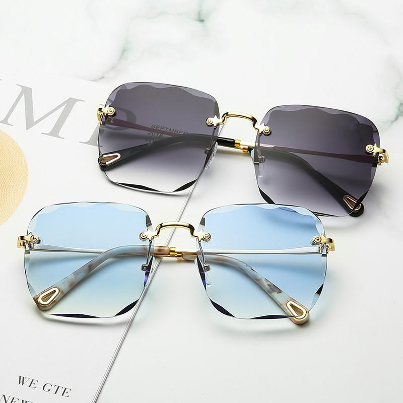 Lunettes de soleil en gros Lunettes de soleil de mer sans monture, lunettes de soleil carrées, designer de marque pour femmes sans cadre 148