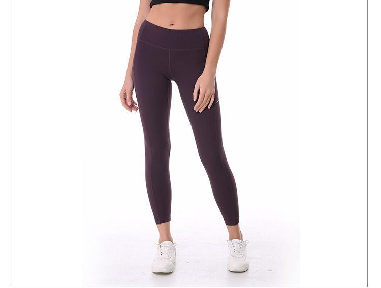 Tamaño fresco mujeres de la yoga pantalones de entrenamiento compresión Yoga polainas de las mujeres pantalones de yoga de moda con bolsillos laterales de la cinta reflectante