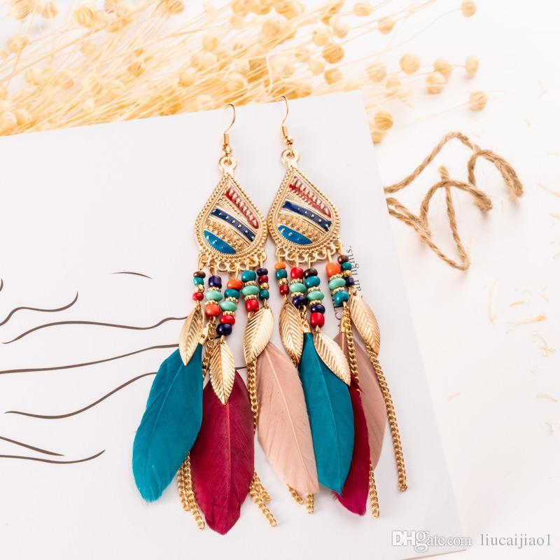 db6b1387d ... Creative feather earrings boho style rice beads earrings long drop  tassel earrings
