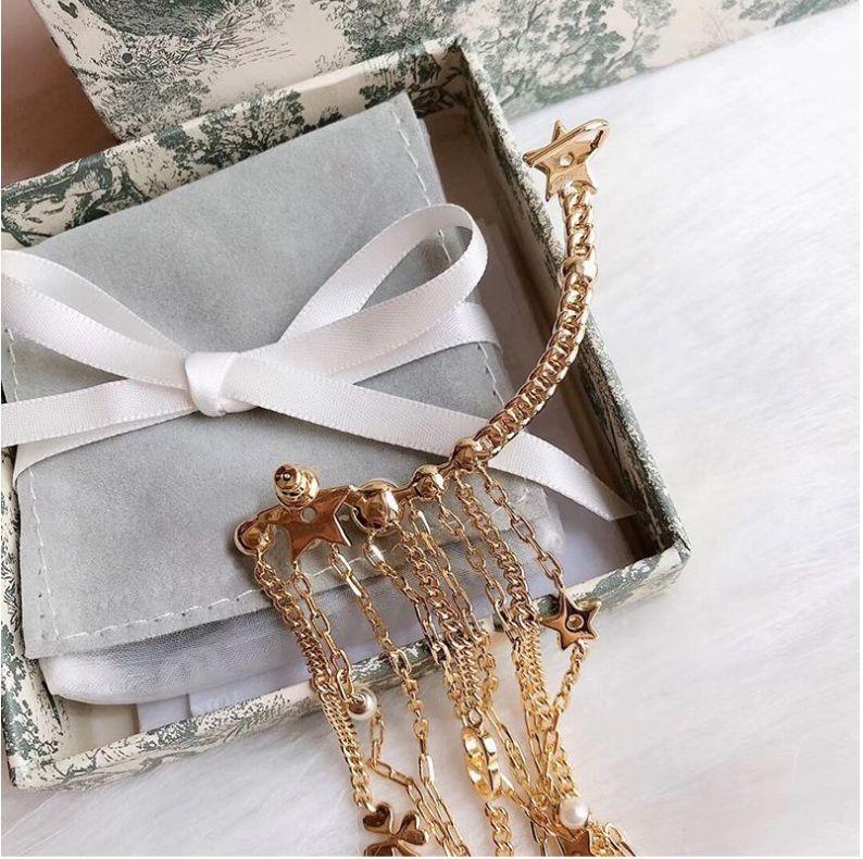 2020 populärer 925 silberne Nadel Material Galvanik Champagner goldener Modetrend asymmetrischer einzelner Ohrring europäische High-End-Luxus-ele