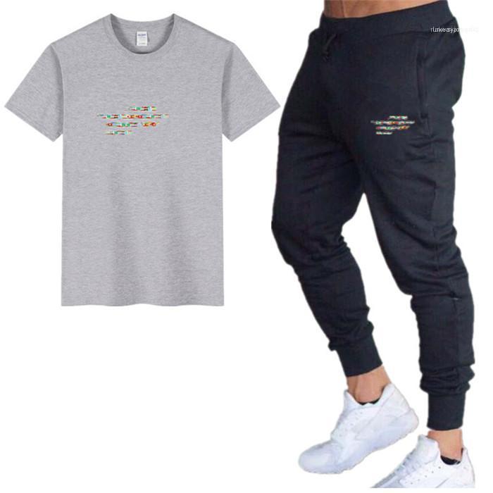 Erkek Spor Tasarımcı 2pcs Tracksuits Katı Renk Mürettebat Yaka Kısa Kollu Homme Giyim Uzun Pantolon Casual Giyim Loose