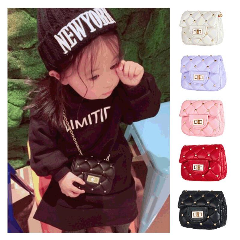 Mini niños bolsa de cuero lindo bolsa remache Cruzado para bebés de la moneda pequeña bolsa de la carpeta de Kawaii Kids Partido Cambio monedero del dinero