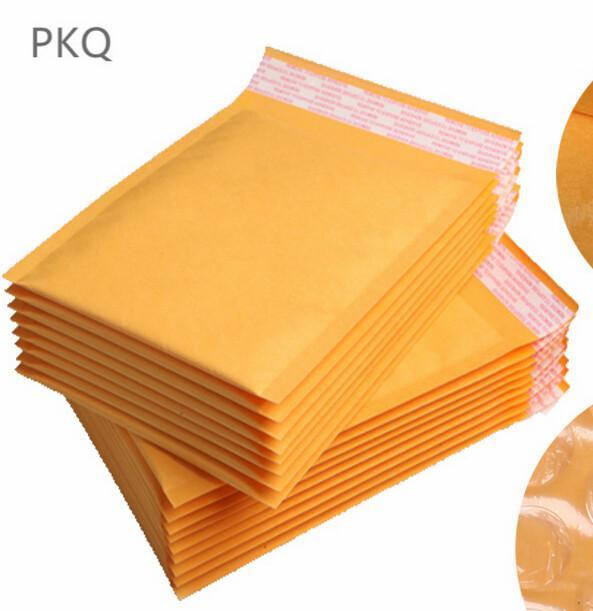 Venta caliente 100pcs Kraft amarillo espuma de sobres Bolsa especificaciones diferentes anuncios publicitarios rellenados envío de sobres con la burbuja de correo Bolsa