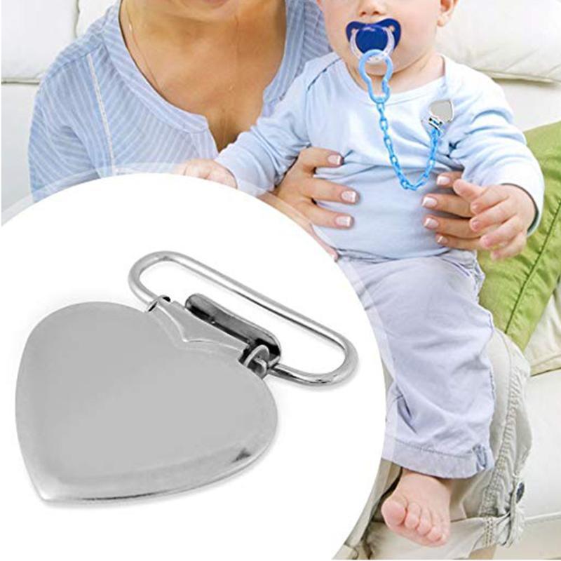 Titular Forma chupete abrazadera cuidado del bebé tirantes de hierro lactante corazón Chupete clip de la liga Alimentación Pezón accesorio