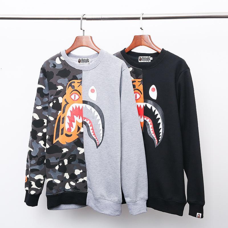 El otoño y el invierno nueva costura de impresión tigre de dibujos animados personalizados luminosa de gran tamaño sueltos alrededor del cuello de jersey de lana tibia