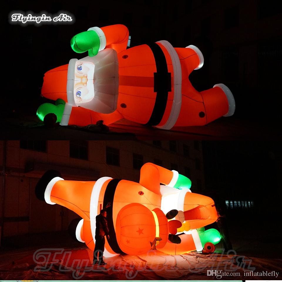 Подгонянное освещение Раздувное взбираясь Санта-Клаус 4m / 6m Дед Мороз нося мешок подарка для напольного украшения стены дома