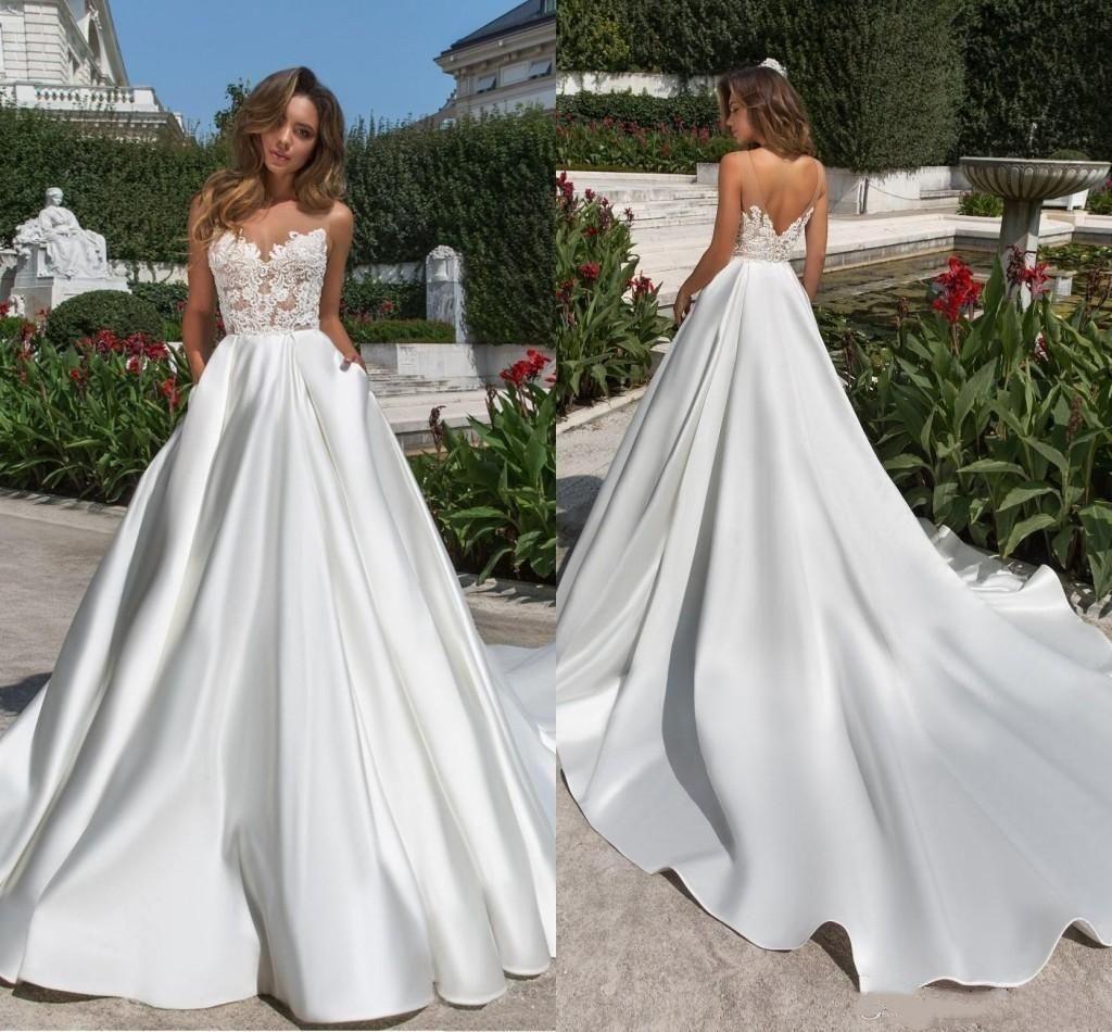 Disegno semplice una linea da sposa in raso Dreses Illusion Top 2020 Sheer collo V Cut Backless Abito da sposa in pizzo con tasche treno lungo Vestidos
