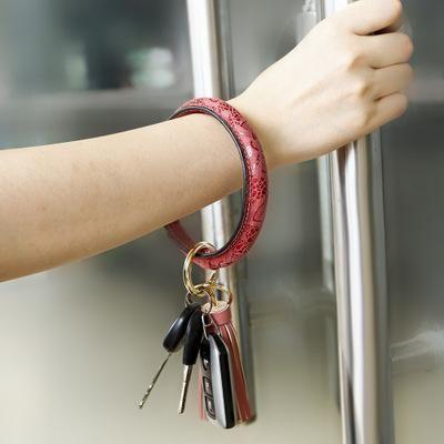 Neue Art und Weise Armband mit Quaste Frauen PU-Leder Schlüsselanhänger Armbänder Schlüsselanhänger Armband Schöne Armband Kreis Armbänder Schmuck