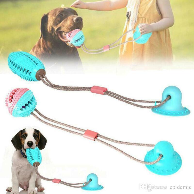 Pet Dog Toys Silicon Ventosa cane della tirata Cani da spingere la sfera Gioco per animali domestici di dispersione alimentari giocattoli da compagnia Tooth pulizia Cani Brush Spazzolino