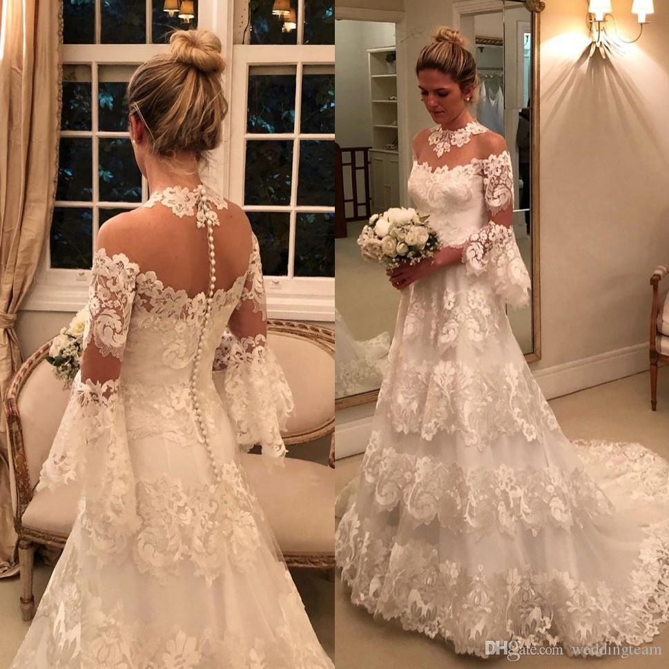 Aturde manga larga vestidos de novia de encaje transparente botones joya cuello cubiertos Vestidos de novia barrer tren robe de mariée