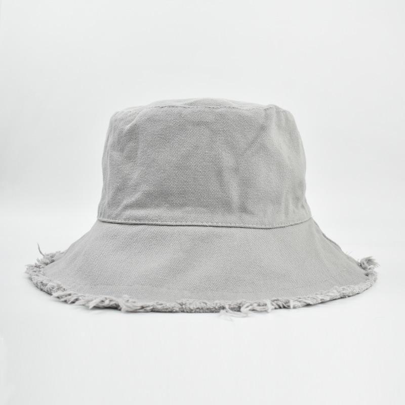 L'ultimo colore solido lavato buco cappello bacino studentessa signora cappello da sole semplice crema solare quattro stagioni cappello pescatore marea