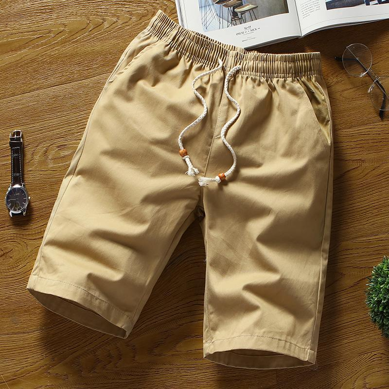 Summer Solid color shorts male , White Straight loose men's breathable elastic waist shorts . cotton for men large size