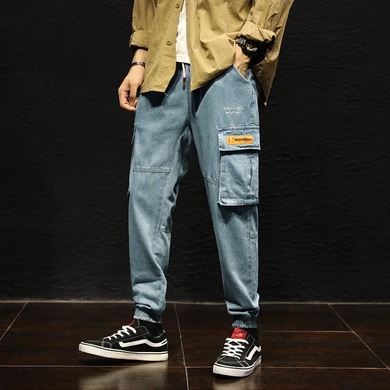primavera e l'estate nuovi 9 punti luce abiti da lavoro degli uomini alla moda di jeans di elastici allentati pantaloni da lavoro legame moda