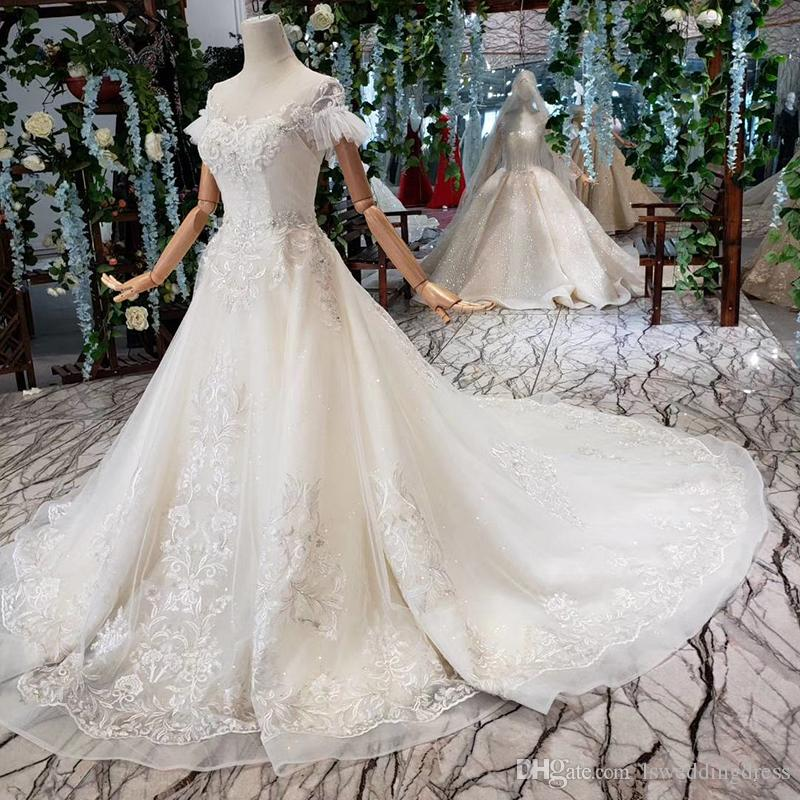 2019 Latest Lebanon Wedding Dresses Feather Short Sleeve Illusion O Neck Open Keyhole Lace Up Back Sequins Crystal Applique Bridal Gowns
