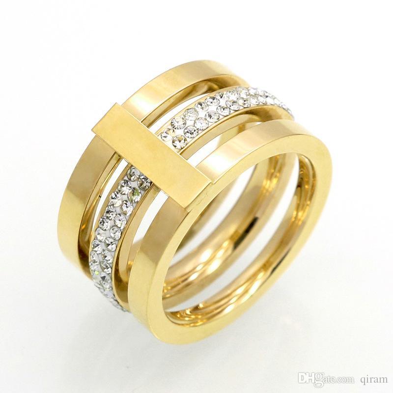 Neu kommen Titanstahlschmucksachegroßverkauf 3 der Marke 316L mit Diamantringen für Frauenhochzeitsringschmucksachegold / Silber / rosafarbene Farbe an