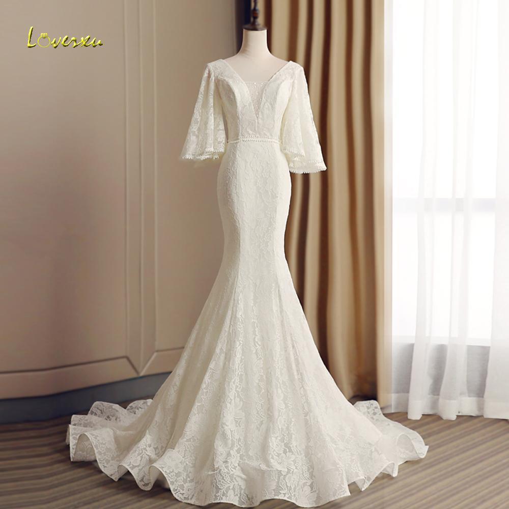 vendita all'ingrosso vestido de noiva pizzo abiti da sposa sirena 2019 sexy scollo av manica tre quarti in rilievo di cristallo tromba abito da sposa