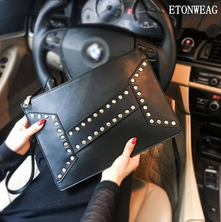 Factory wholesale men handbag stylish cool rivet punk hand clutch bag vintage leather wrist bag imitation old leather hand clutch envelope b