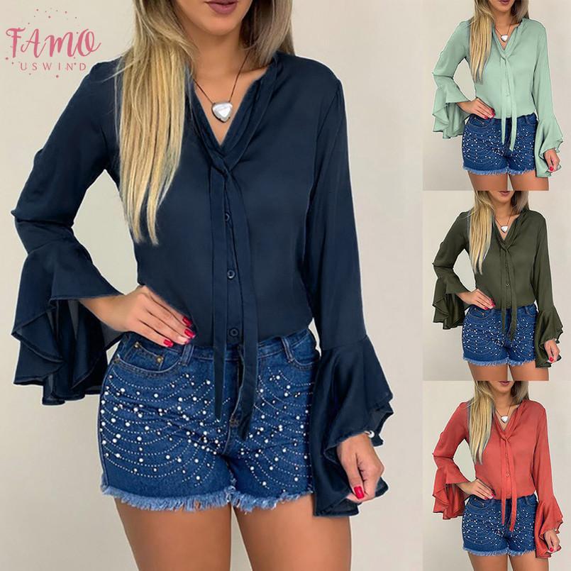 Botón de moda para mujer otoño invierno color sólido Trump mangas del lazo Tops al por mayor de la camisa de la nave libre de las mujeres Z4