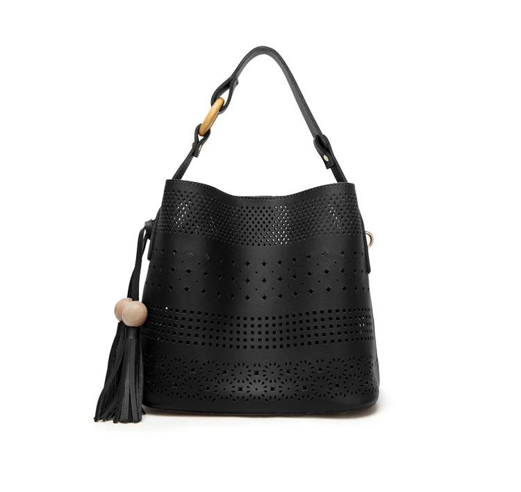 2019 New Fashion Street simples oca Design Um saco de ombro Cut Out Tassel Handbag MX200603