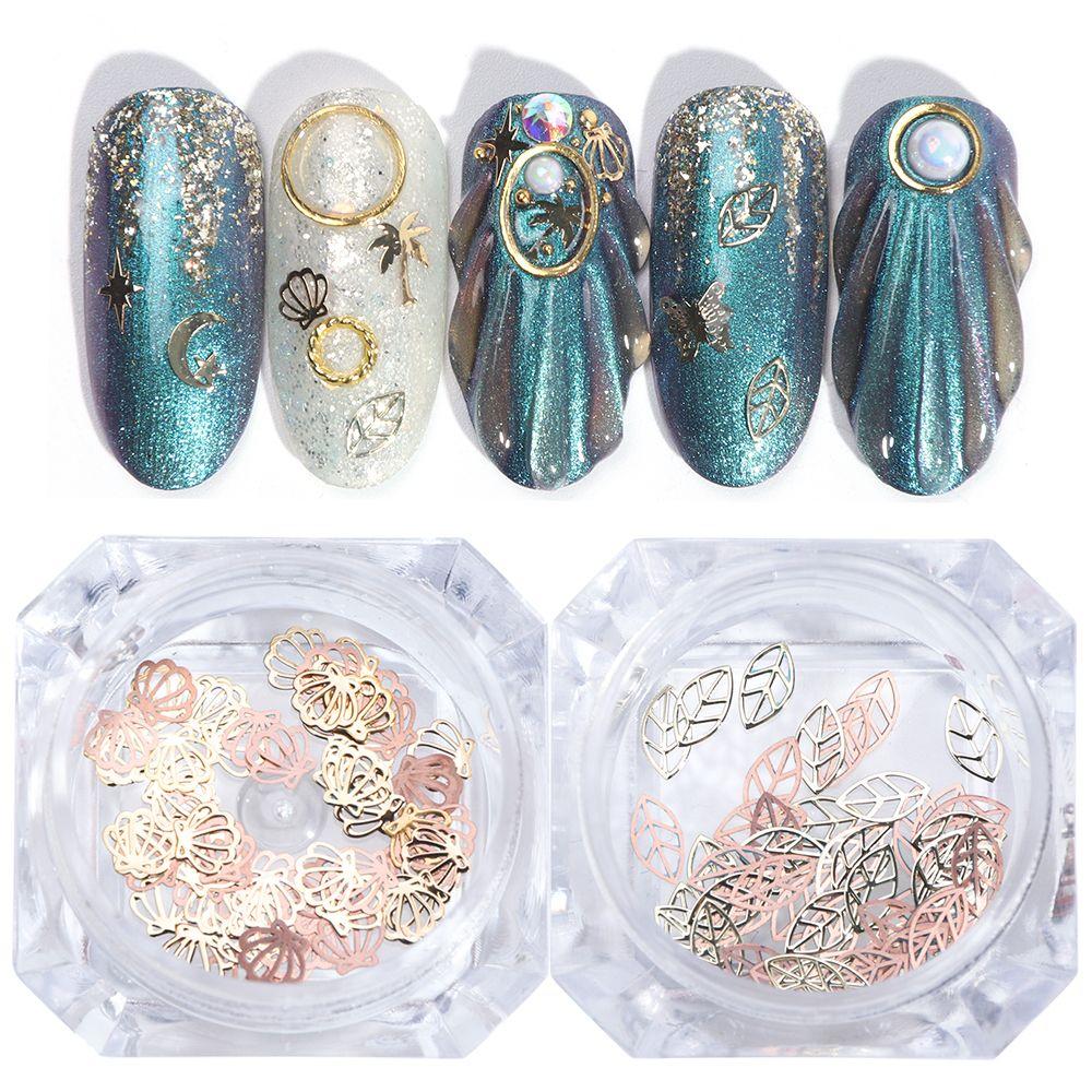 2 Designs prego de ouro Decorações Arte metal Conjunto Fatias Shell Moon Star projeto brilhante ocas Sequins prego Pedrinhas Manicure TR763