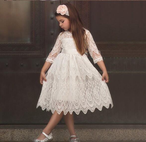 Les nouveaux modèles d'automne de vêtements et d'explosion d'hiver pour enfants filles dentelle robe col rond arc robe de princesse cravate