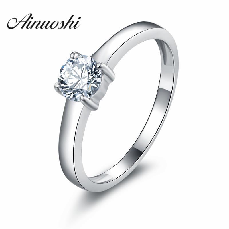 Los diamantes AINUOSHI Sona simulados anillo de compromiso del anillo de compromiso anillo de las mujeres romántica cuatro garras descuentos, regalo de la manera Uloveido Y200106