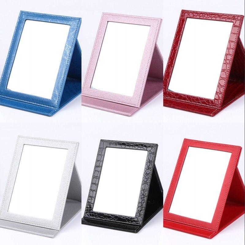 Espelhos Dobráveis PU Tamanho Pequeno Doce Cor Cosméticos Espelho Vermelho Preto Roxo Multi Cores Acessórios Cosméticos Nova Chegada 8hl L1