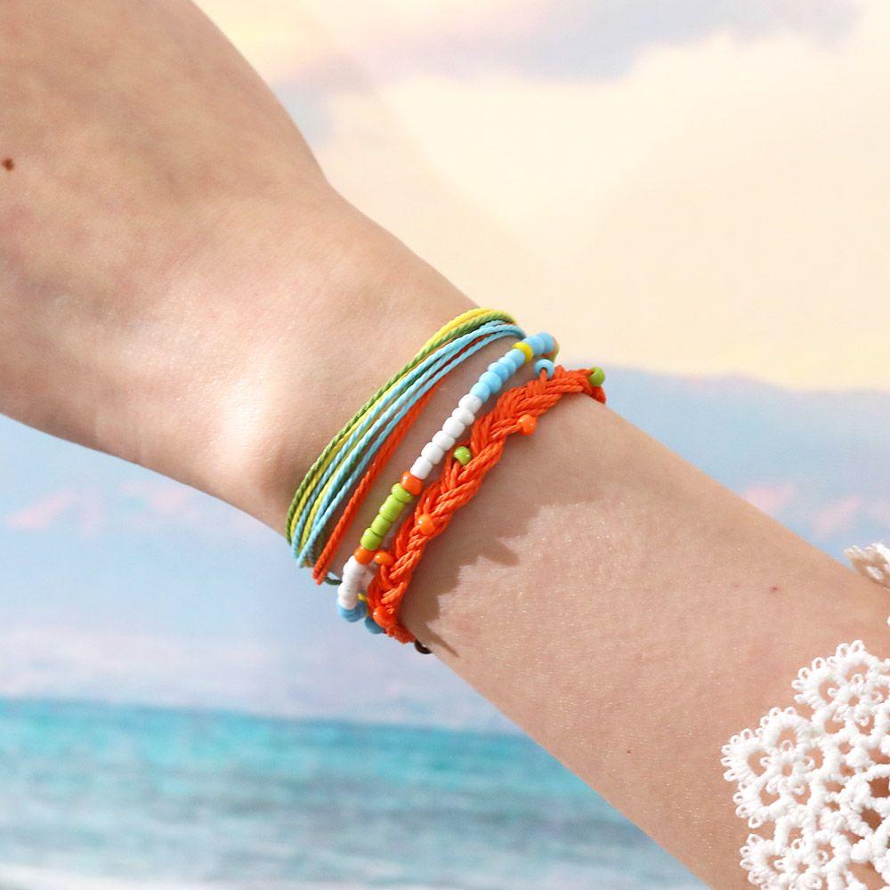 3pcs / Set pulsera tejida de múltiples capas hecha a mano por las mujeres de los hombres de moda bohemia trenzada cuerda de la cera de la semilla conjunto de joyería de perlas pulsera de la amistad de bricolaje