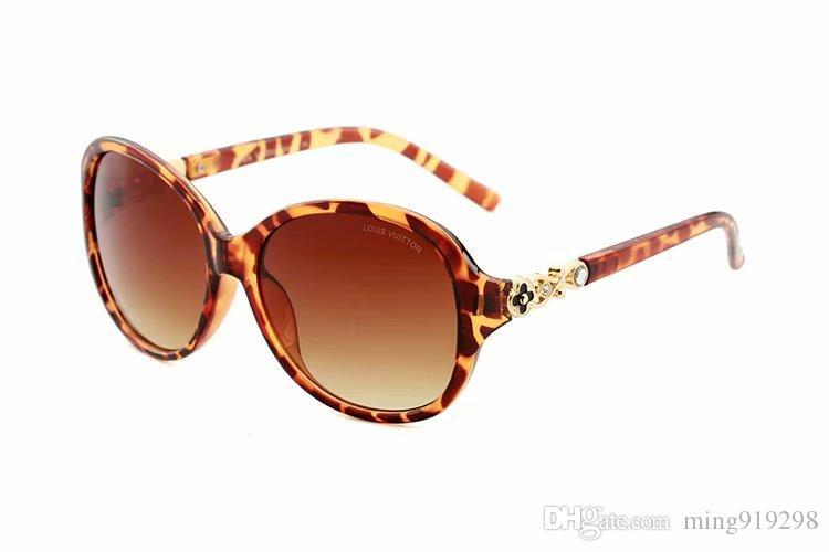1 unids Moda gafas de Sol Redondas Gafas Gafas de Sol Diseñador de la Marca Negro Marco de Metal Oscuro 57mm Lentes de Cristal Para Hombre Para Mujer Mejores Casos Marrones