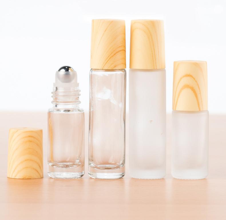 5ML 10ML متجمد الزجاج الأسطوانة زجاجة خشب الخيزران مثل الطباعة من الضروري النفط نموذج لفة عطر في زجاجة عطر قوارير الصلب الكرة