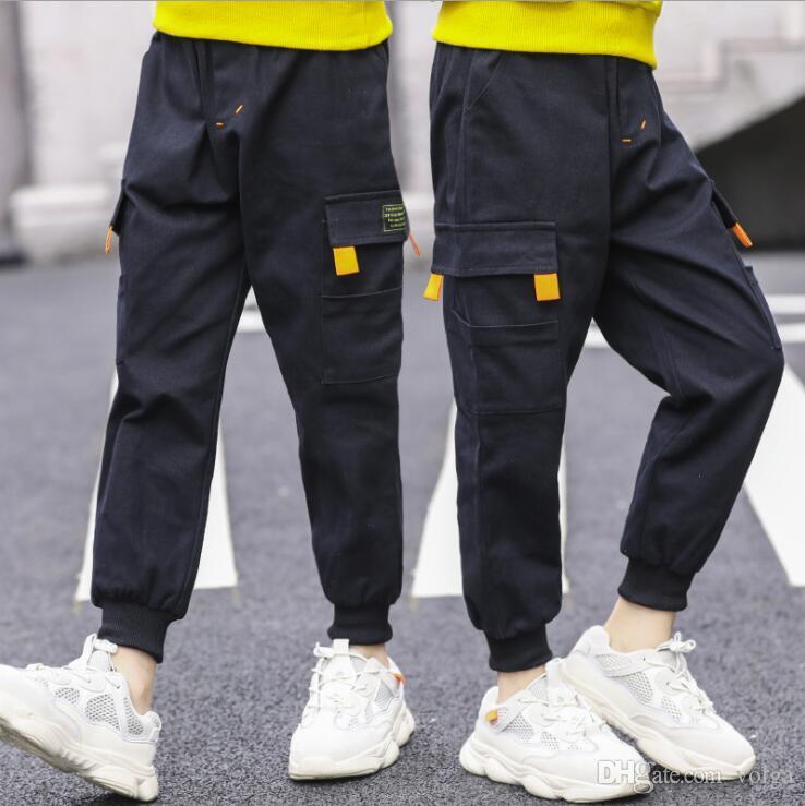 pantalones muchachos de la ropa de otoño e invierno de los nuevos niños chicos pantalones casuales en los deportes de los niños grandes, además de los pantalones