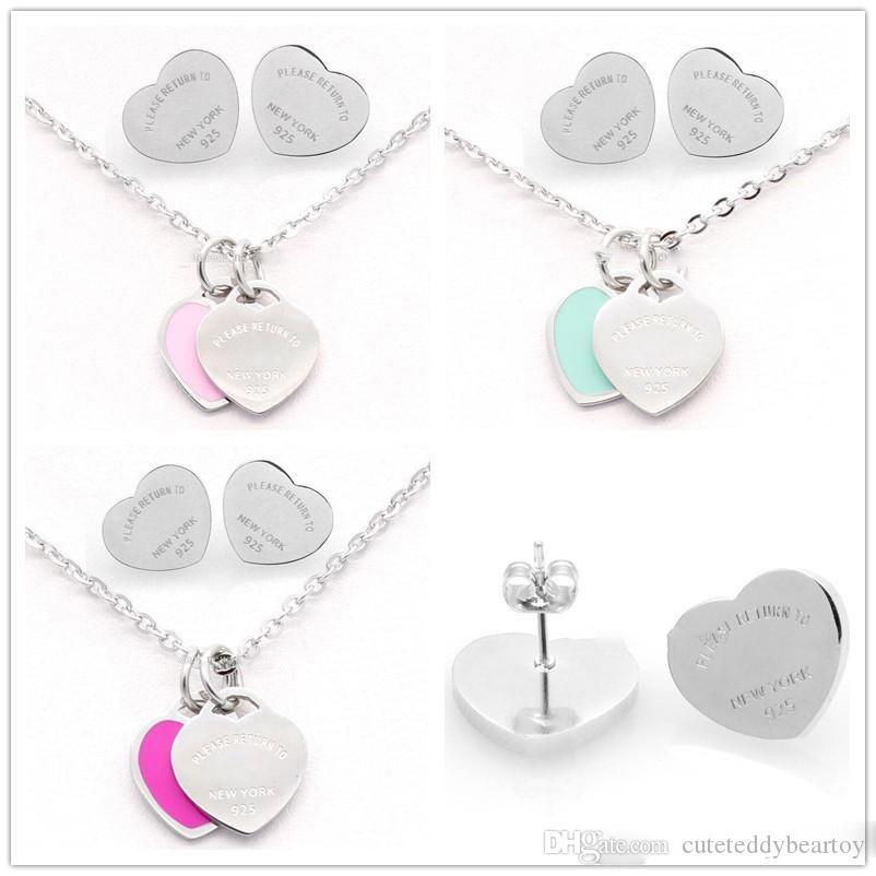 L'insieme dei monili delle donne della signora di colore dell'argento di titanio Lettera T doppio cuore orecchini collana For Fashion Wedding Love Marca