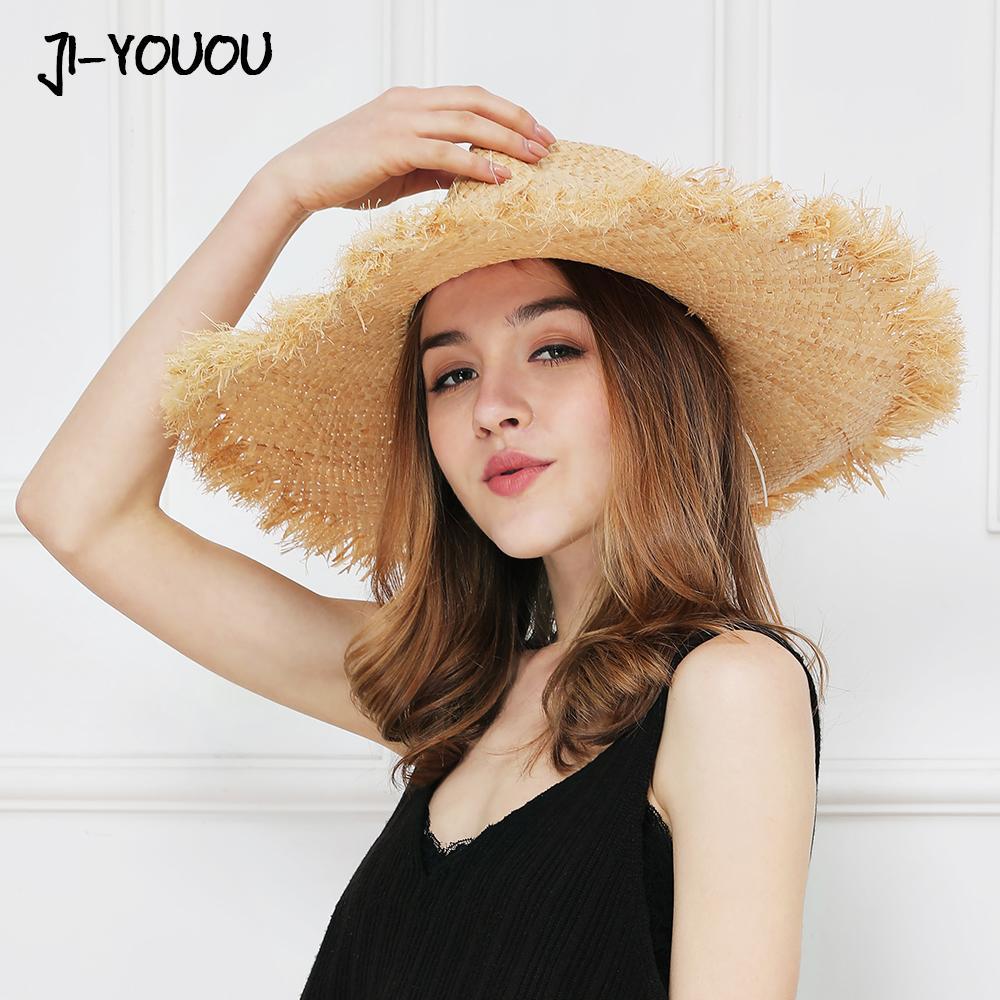 Chapeau de plage sauvage de mode casual Rafia herbe chapeau de cowboy occidental protection UV modèles masculins et féminins parasol pare-soleil chapeau de paille D19011106