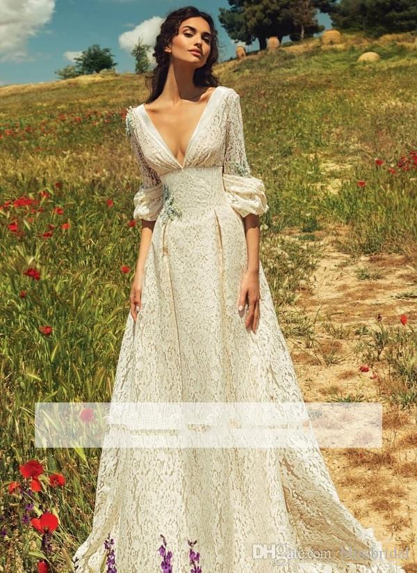 2019 Romantische böhmische volle Spitze einfache rückenfreie Hochzeitskleid V-Ausschnitt lange Ärmel Garden Beach Brautkleider Fairy Sweep Zug der 1970er Jahre Hippie