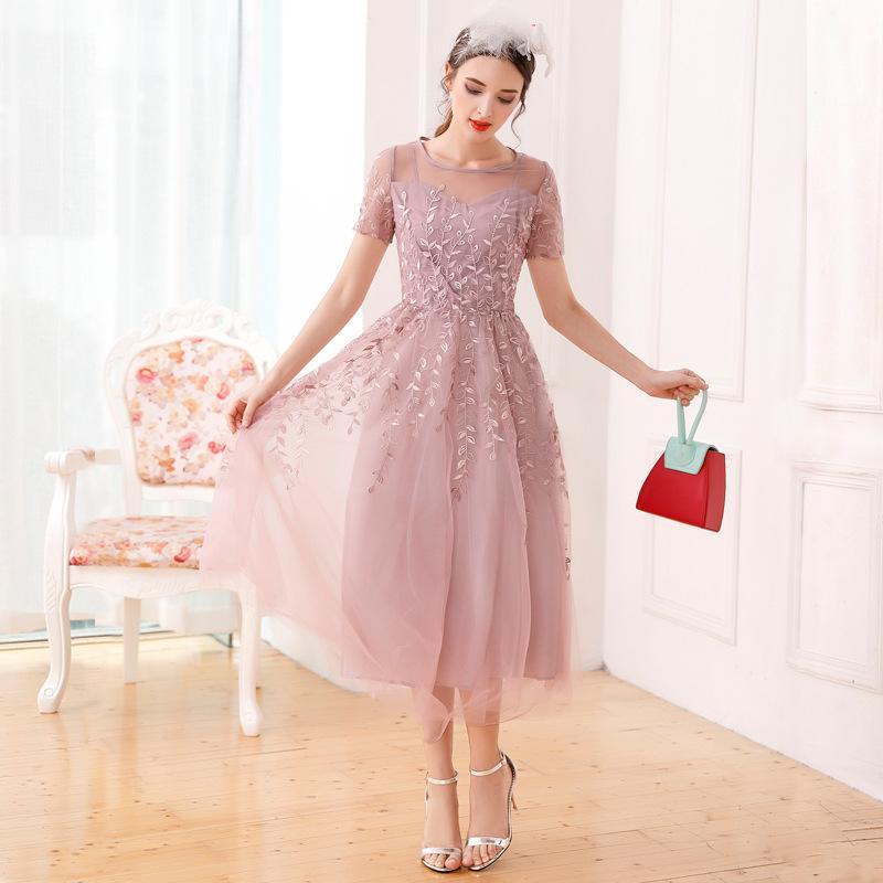 Estate vestito nuovo europeo e l'industria pesante ricamo marea di modo sottile altalena della vita delle donne americane maglia a maniche corte vestito
